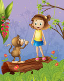A girl and a monkey in the forest Royalty Free Stock Photos