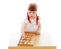The girl in the Montessori environment Royalty Free Stock Images