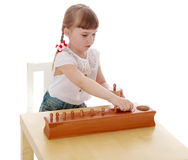 The girl in the Montessori environment Stock Images