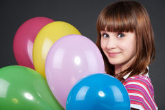 Girl with montley balloons Stock Photography