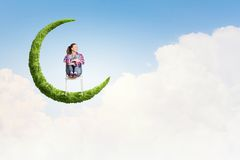 Girl on moon Royalty Free Stock Images