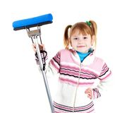 Girl with mop. A little girl with mop royalty free stock image