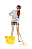 Girl mopping. Young girl mopping isolated on white Royalty Free Stock Images