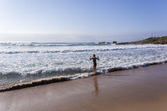 Girl Morning Beach Swim royalty free stock image