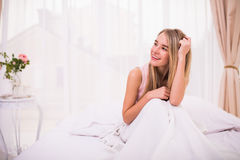 Girl in morning bed with good mood Royalty Free Stock Photos