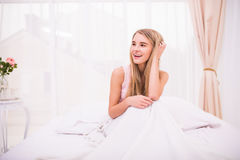 Girl in morning bed with good mood Stock Images