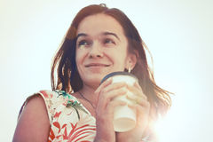 Girl with morning coffee in sunlight Royalty Free Stock Photo