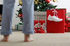 Girl in the morning looking for Christmas gifts. Royalty Free Stock Photo