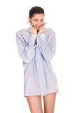 Girl in the morning with a men's shirt Stock Images