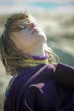 Girl in the morning sunshine. Beautiful girl in the morning sunshine on the beach, blurred background Royalty Free Stock Image