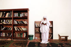 Girl in Mosque. Reading book Stock Photography