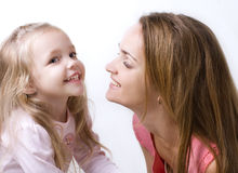 Girl with a mother Stock Photography