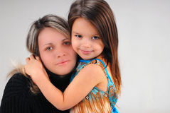 Girl with mother Stock Photo