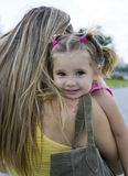 Girl and mother. Little girl on mother's hands Royalty Free Stock Images