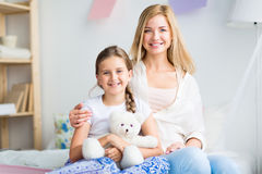 Girl with mother Stock Image