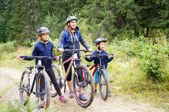 A girl with mother and brother enjoying cycling Stock Photo