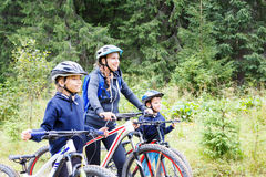 A girl with mother and brother enjoying cycling Stock Photography