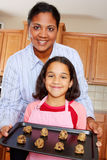 Girl And Mother With Cookies Royalty Free Stock Photos