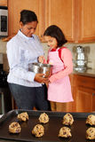 Girl And Mother With Cookies Stock Photography