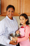 Girl And Mother Cooking Royalty Free Stock Photography