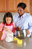 Girl And Mother Cooking Stock Photos