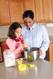 Girl And Mother Cooking Royalty Free Stock Image