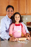 Girl And Mother Cooking Stock Photography