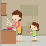 Girl and mother cooking in the kitchen. Vector Illustration of a mother and daughter cooking.girl and mother cooking in the kitchen.happy family with mom and Royalty Free Stock Photography