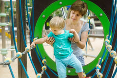 Girl with mother developing dexterity stock image