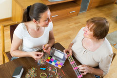 Girl and mother with elastic bands Royalty Free Stock Photography