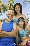 Girl (10-12) with mother and grandfather front view portrait. Stock Photos