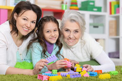 Girl with mother and grandmother. Little girl playing with mother and grandmother Stock Photography