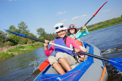 Girl with mother kayaking Royalty Free Stock Image