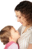 Girl and mother looked at each other. Little girl and mother looked at each other Stock Image