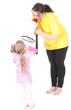 Girl and mother with megaphone Stock Photo
