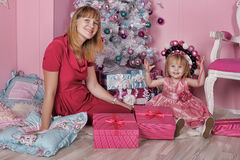 Girl and mother near Christmas fir-tree Stock Image