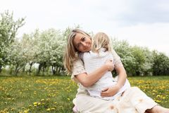 Girl with mother in the park Stock Images