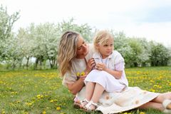 Girl with mother in the park Royalty Free Stock Photo