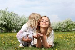 Girl with mother in the park Stock Image