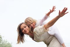 Girl with mother in the park Stock Photography