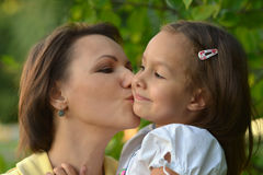Girl with mother in park Stock Image