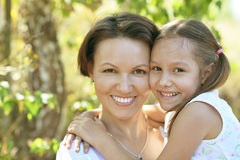 Girl with mother in park Stock Photo