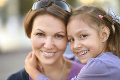 Girl with mother in park Stock Photos