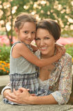 Girl with mother in park Royalty Free Stock Image
