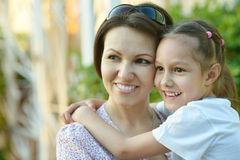Girl with mother in park Royalty Free Stock Photography