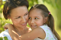 Girl with mother in park Stock Images