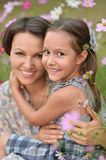 Girl with mother in park Royalty Free Stock Photo