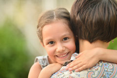 Girl with mother in park Stock Photography