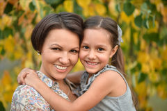 Girl with mother in park Royalty Free Stock Photos