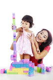 Girl with mother playing lego Stock Images